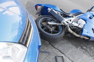 Car that hit a motorcycle.